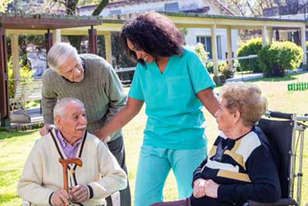 Home care aide socializing with companions